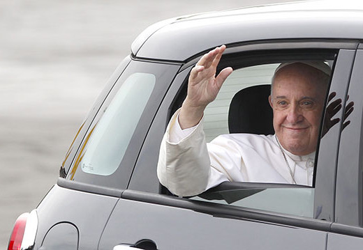 Pope Francis waves from his Fiat as he leaves Atlantic Aviation in Philadelphia on Saturday, Sept. 26, 2015. (Charles Fox/Philadelphia Inquirer/TNS)